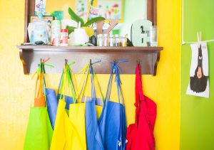 Colourful aprons hanging
